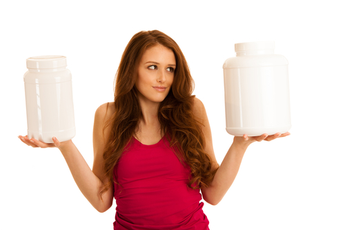 Woman holding whey protein