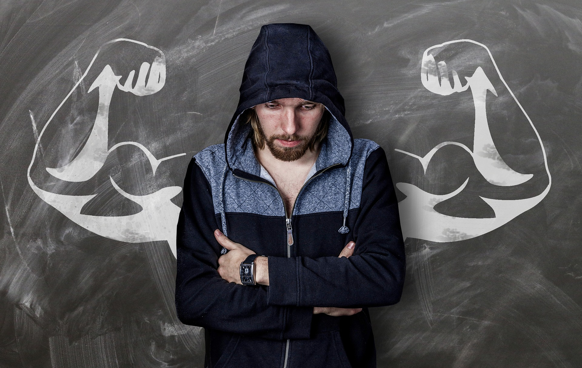 man standing in front of muscular logo