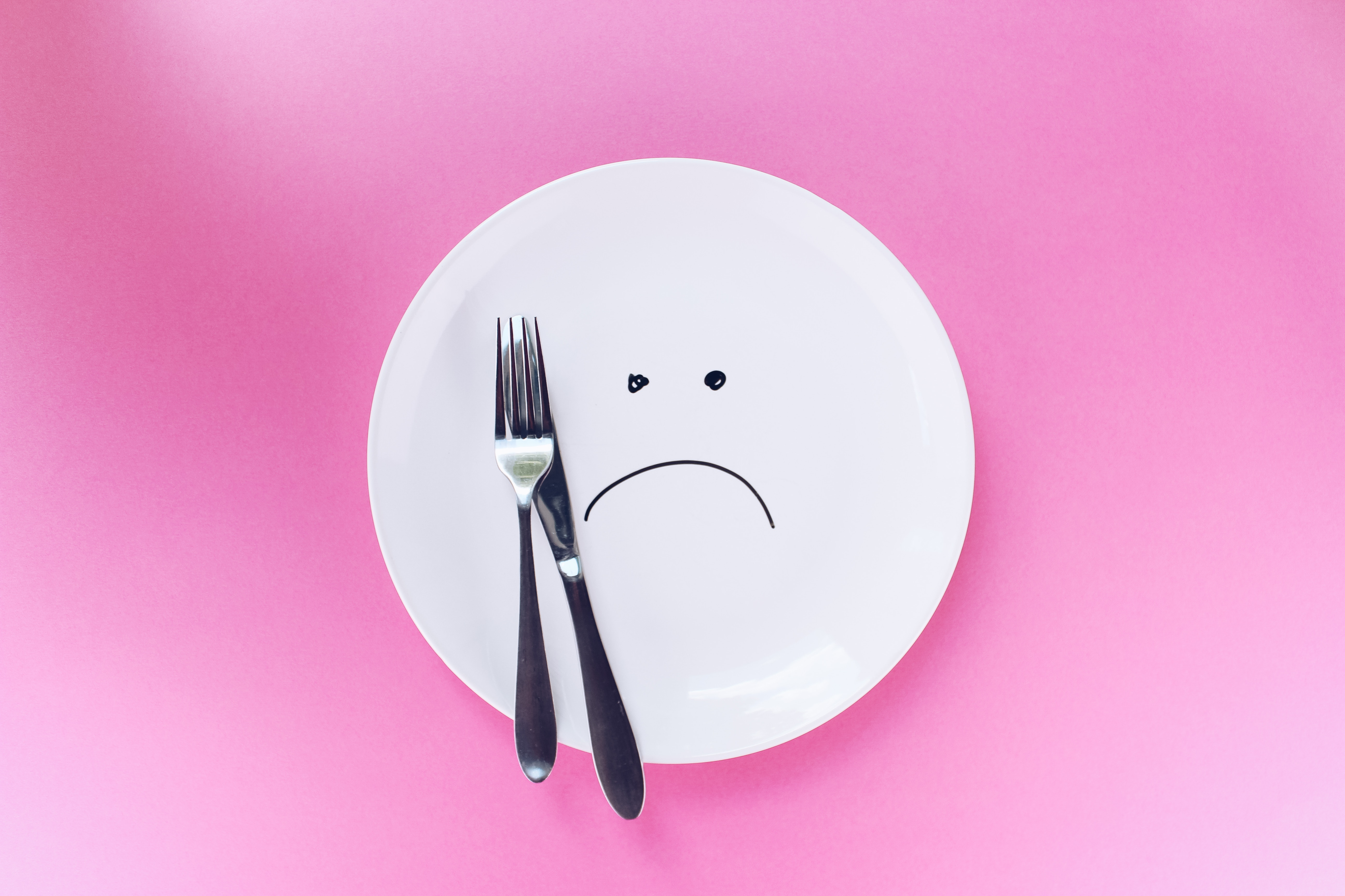 clean dish with sad face